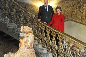 The Duke and Duchess of Devonshire take a look at the Jeff Koons Poodle sculptured from Polychromed wood which forms part of the exhibition.