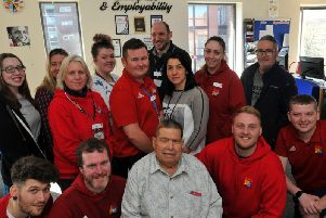 Bernard Edmunds, front centre, with some of the team at Wigan Youth Zone, as they dedicate the Enterprise room to him