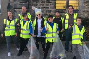 Members of Filey Youth Club wear hi-vis vests as they collect litter from streets around St John's Church on West Avenue.
