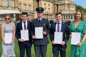 Fab Five: The five members of 868 (Mirfield) Squadron Air Cadets with their certificates at Buckingham Palace. Three other cadets were also invited but could not make it on the day.
