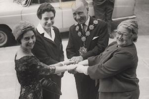 Helping hand: Eileen Fenton is pictured when she was secretary of Dewsbury Swimming Club with one of her star pupils Jean Oldroyd, who took part in the Commonwealth Games in Cardiff in 1958. Also pictured the then Mayor and Mayoress of Dewsbury, Councillor and Mrs Tom Tarney. Picture kindly loaned by Catherine Tarney.