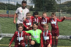 Holy Spirit's school football team, with PE teacher Joe Ratcliffe, were crowned Premier Stars Champions..