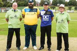 Team captains David Plant and Gary Rogers, pictured last year with the match umpires.