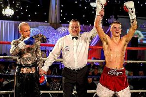 has his hand raised after securing a unanimous points win over Adam Bannister on his professional debut.