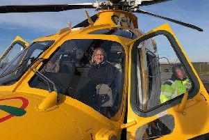 Sarah Withers in the cockpit of the Notts and Lincs Air Ambulance