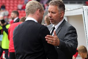 Darren Ferguson shakes hands with Grant McCann at the Keepmoat in September 2017 when they were in charge of the opposite clubs to the ones they will manage this weekend