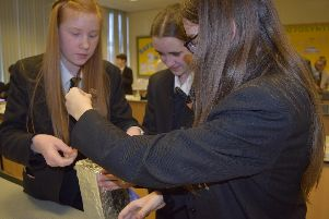 Year 8 students at Swinton Academy learning how to make a flotation device
