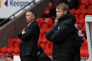 Darren Ferguson with Grant McCann in the foreground during a past meeting between Rovers and Peterborough