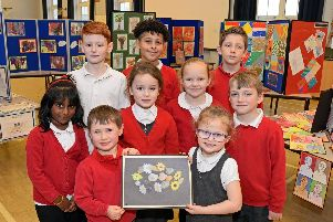 Pupils with their works of art at Bentley High Street Primary School