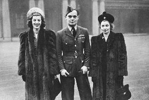 RAF fighter ace Douglas Bader (1910 - 1982) leaves Buckingham Palace after receiving new bars to his DSO and DFC, 27th November 1945. Accompanying him are his wife Thelma (right) and Thelma's sister Jill Addison. Bader lost both legs during an aerobatic stunt in 1931, but his skills as a pilot were unaffected. (Photo by Keystone/Hulton Archive/Getty Images)