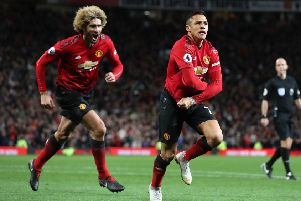 """Manchester United's Alexis Sanchez (right) celebrates scoring his side's third goal of the game with Marouane Fellaini during the Premier League match at Old Trafford, Manchester. PRESS ASSOCIATION Photo. Picture date: Saturday October 6, 2018. See PA story SOCCER Man Utd. Photo credit should read: Martin Rickett/PA Wire. RESTRICTIONS: EDITORIAL USE ONLY No use with unauthorised audio, video, data, fixture lists, club/league logos or """"live"""" services. Online in-match use limited to 120 images, no video emulation. No use in betting, games or single club/league/player publications."""