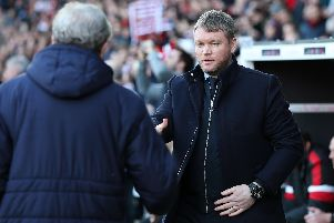 Grant McCann shakes hands with Crystal Palace manager Roy Hodgson