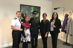 Chief Constable Dee Collins, left, with PC Fiz Ahmed, centre, modelling the alternative uniform during a meeting with the Muslim Women's Council.