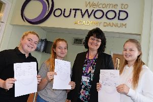 Celebrating their GCSE results with Principal Jayne Gaunt are l-r Lucy Kennedy, 16, of Wheatley, who will be studying A Levels at Outwood Academy Danum, Grace Kemp, 16, of Armthorpe, who will being heading to New College to study A Levels and Kaitlyn Willey, 16, of Intake, who has gained a Hairdressing Apprenticeship. Picture: Marie Caley NDFP-23-08-18-GCSEDanum-1