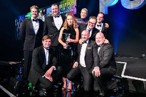 The winning team from the Inn Collection Group with Alan Carr.