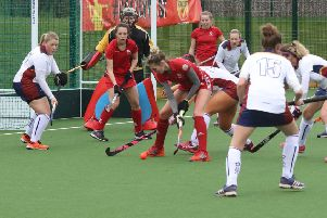 Josie Rice, supported by Summer Muirhead and Grace McGarvey, tries to find a way through the massed ranks of Liverpool Sefton defenders