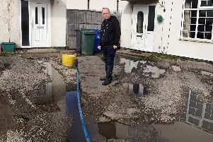 David Jeeves, pictured on his front drive, which along with the back garden suffer from constant flooding. Picture: Marie Caley