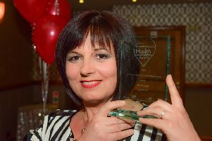 Gill Hanratty with her trophy from the 2018 Best of Health Awards.