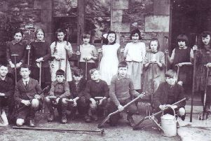 Wray School gardening group, prior to 1929. Back row (from left) Rena Townson, Betty Askew, Eva Bevins, Lucy Taylor, Ruth Woodhouse, Grace Ridding, Mary Holroyd, Jessie Marian Dixon, Ella Hornby. Front row (from left) Billy Hodgson, Arthur Whitehorn, Bob Wilson, Dick Kenyon, George Robinson, John Wilson, Tom Askew.