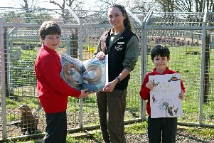 Bessacarr Primary pupils present copies of prize winning book The Lost Words to Yorkshire Wildlife Park staff