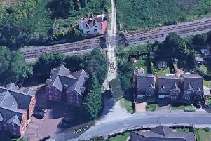 An underpass is expected to be built off Kelsey Gardens in Bessacarr joining the new Manor Farm estate. Pictured is a level crossing at nearby Carr Lane.