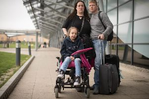 Emma Appleby (left), Lee Moore and their daughter Teagan who has severe epilepsy and was prescribed a cannabis-based medicine but has not been able to access it on the NHS, at London Southend Airport, Essex, after having the medicine they purchased in Amsterdam confiscated by customs officers.