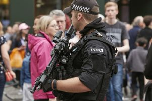 An armed police officer on the streets of Manchester