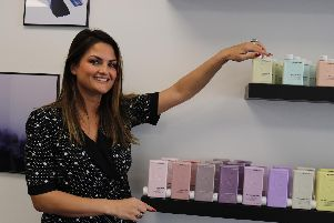 Gemma Thomas, the manager, with Kevin Murphy products.
