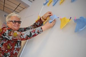 Anne Gosling, Host, pictured hanging up Tour de Yorkshire themed bunting. Picture: NDFP-26-03-19-Renew-3