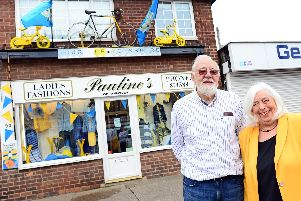 Pauline and Ray Middleton, pictured by their window, on Bentley High Street. Picture: Marie Caley NDFP-23-04-19-TDYWindowPauline's-5