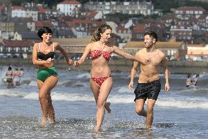 Summer holidays in sun kissed Scarborough .Emily Taylor , Becky Lumb, Patrick Eaton have fun. pic Richard Ponter 153410a