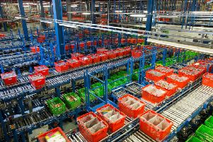"""File photo dated 21/12/15 of Ocado's Customer Fulfilment Centre in Hatfield, as the online grocer confirmed the sector's fierce price war is beginning to ease off as the Brexit-hit pound starts to push up prices. PRESS ASSOCIATION Photo. Issue date: Tuesday March 14, 2017. Chief executive Tim Steiner, said the group was seeing the """"first signs of a change in market pricing"""" after years of food price deflation sparked off by competition from German discounters Aldi and Lidl. See PA story CITY Ocado. Photo credit should read: Daniel Leal-Olivas/PA Wire"""