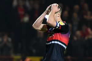 Tommy Rowe is distraught after his decisive miss for Doncaster Rovers in the shoot-out (Picture: Harriet Lander/Getty Images).