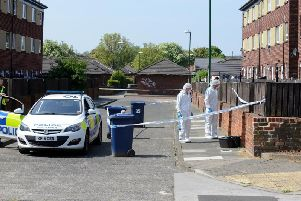 Police investigating the the scene following the death of Simon Bowman in High Street, Jarrow.