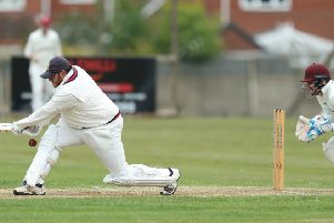 Woodlands wicketkeeper Greg Finn keeps a close eye on Townville's Ritchie Bresnan during last Saturday's Bradford Premier League clash. Picture: John Clifton