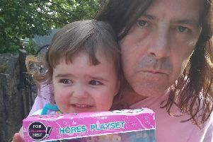 Joe with daughter Daisy and the toy set.