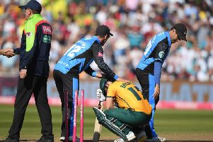 Hamish Rutherford and Daryl Mitchell of Worcestershire Rapids console Ben Duckett of Notts after defeat during the Vitality T20 Blast semi-final.