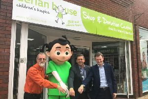 Nigel Stewart, Derian Danni, David Robinson and Councillor Peter Wilson announce the Chorley Live and Derian House partnership at the Derian House shop on Cleveland Street.