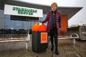 Catherine Furlong with a coffee cup bin outside Starbucks Giltbrook