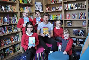Author Daniel Henshaw with pupils from Brinsley Primary School in the new library