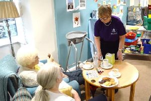 Staff looking after elderly residents at the Ladycross House care home in Sandiacre.