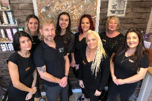 Owner Gemma Worthington (front, second right) with the rest of her team at the Barefeet Hair and Beauty salon in Ilkeston.