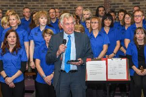Special guest, Coun Tony Harper, addresses the audience at the event, in front of singers who took part. (PHOTO BY: Reg Lowe, Beauvale Photographic Society)