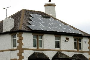 Solar panels are a popular way for households to harness greener renewable energy. Photo: PA/Rui Vieira