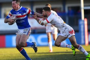 Tommy Makinson gets a tackle in