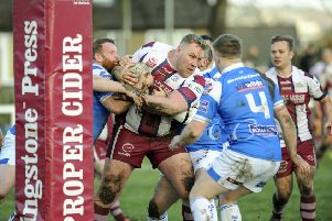 Thornhill's Zach Johnson is tackled by the Rochdale Mayfield defence during his side's Challenge Cup second round defeat last Saturday. Picture: Scott Merrylees