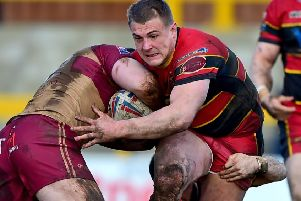 Chris Annakin attempts to break up a tackle by Sheffield's Patrick Burns and Corey Makelim as he looks to set up a Dewsbury Rams' attack in last Sunday's Championship clash at Tetley's Stadium. Picture: Paul Butterfield