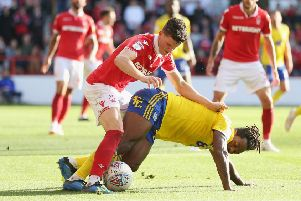 NOTTINGHAM, ENGLAND - AUGUST 25: Sam Byram of Nottingham Forest and Jacques Maghoma of Birmingham during the Sky Bet Championship match between Nottingham Forest and Birmingham City at City Ground on August 25, 2018 in Nottingham, England.  (Photo by Alex Morton/Getty Images)