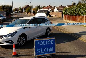 Police sealed-off Park Hall Road, at Mansfield Woodhouse, as part of a murder investigation.