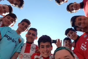 Darley Dale resident Mark Daly donated a huge collection of old football kits to Palestinian children when he visited a refugee camp in the West Bank recently.